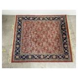 Handwoven red & blue square area rug
