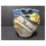 Unmarked raised design teacup