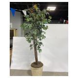 Large artificial tree in wicker basket