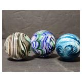 Three signed art glass shooter marbles