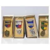 Four marksman medals