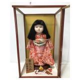 Porcelain Asian doll in traditional kimono