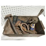 Collection of antique tools and parts in metal bin