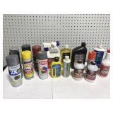 Large assortment of essential garage fluids