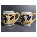 Pair of unmarked vintage embossed mugs