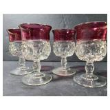 Set of 4 small glass red rim goblets