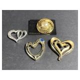 Lot of 4 silver & gold toned brooches