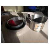 stock pot and kettles and glass coffeepot