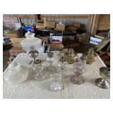 several oil lamps including 1 aladdin and 2
