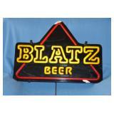 Blatz, lighted