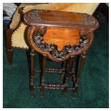 Highly carved small stand