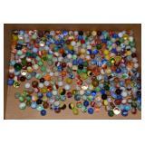 Large jar of marbles, displayed