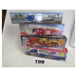 LOT OF 4 TRUCKS, NEW IN BOX (SUNOCO, EXXON, FIRE