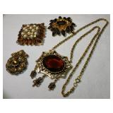 DECORATIVE BROOCHES & AMBER NECKLACE
