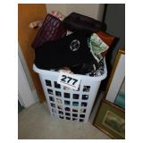 LAUNDRY BASKET FULL OF PURSES