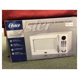 Oster 11 cu ft. Microwave Oven, open box,