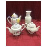 Three assorted tea pots, one vase made in Japan