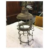 metal light stand, perhaps for candles