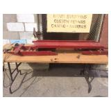 large red bobsled, antique, early 1900s