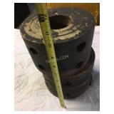 Two antique pulleys from machine shafts