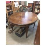fantastic oval solid walnut french table.