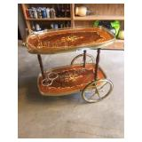 fancy inlaid tea cart , brass wheels