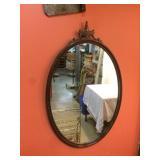 antique walnut mirror, carved crest, oval shape