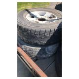 285/70/17 8 lug aluminum rims & tires off 06 ford