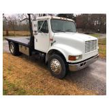 1999 INTERNATIONAL 4700 S/A FLATBED TRUCK