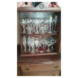 China cabinet full of Crystal stemware and 1904