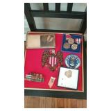 Military medals, badges, stripes and needlepoint