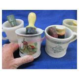 4 old shaving mugs with lather brushes