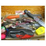 flat with several knives -sharpening stones -etc