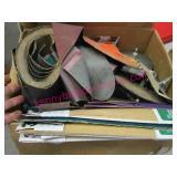 box of sandpaper & accessories for sanding