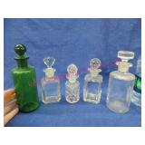 5 old glass bottles with stoppers
