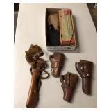 BX OF GUN CLEANING KITS & HOLSTERS