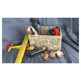Basket with vintage plane, train engine, holster,
