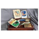 Wooden tray with vintage advertising, toys, book,
