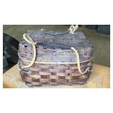 Antique picnic basket with rope handles