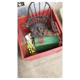 Crate with doll chair, books and car tag pieces