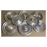 Group of 8 various hubcaps