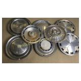 Group of 8 hubcaps
