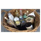 Basket of vintage ladies cologne and creme jars,