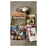 Group of boxes with linens, glassware, figurines,