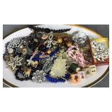 Vintage brooches and other costume jewelry on