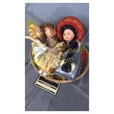 Basket of vintage dolls and toy iron