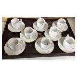 Set of 8 Czechoslovakia cups and saucers on  wood