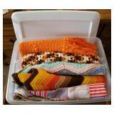 Storage Tote Full of Afghan Throw Blankets