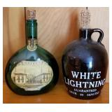 Two Older Liquor Bottles with Stoppers