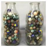 Two Quart Milk Bottles Of Marbles